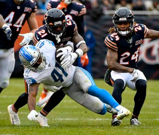Lions running back J.D. McKissic runs against Bears strong safety Ha Ha Clinton-Dix and cornerback Buster Skrine in the second half of the Lions' 20-13 loss on Sunday, Nov. 10, 2019, in Chicago.
