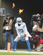Flags fly on a pass interference call on Lions cornerback Darius Slay in the third quarter.