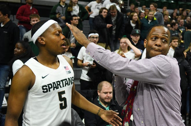 Zachary Winston, right, jokingly tries to steal the headband from his brother, Michigan State point guard Cassius Winston, during an exhibition game this month at the Breslin Center in East Lansing.