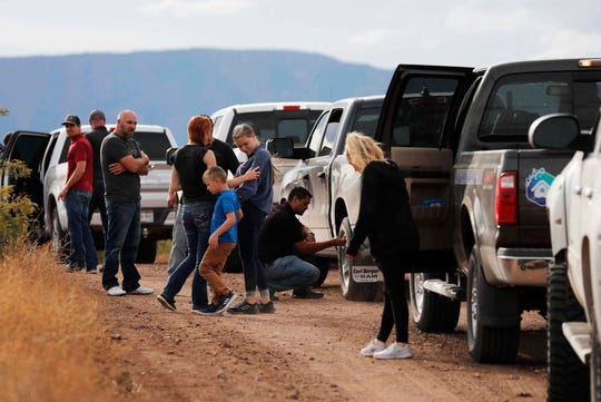 A caravan of friends and relatives of the LeBaron family arrive at the site where nine U.S. citizens, three women and six children related to the extended LeBaron family, were slaughtered when cartel gunmen ambushed three SUVs along a dirt road near Bavispe, at the Sonora-Chihuahua border, Mexico, Wednesday, Nov 6, 2019.