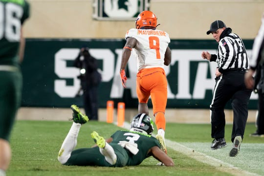 Michigan State safety Xavier Henderson can only watch as Illinois wide receiver Josh Imatorbhebhe runs away with the ball for a touchdown in the fourth quarter.