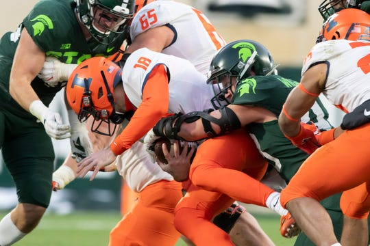 Illinois quarterback Brandon Peters is sacked by Michigan State linebacker Noah Harvey in the second quarter Saturday in East Lansing.