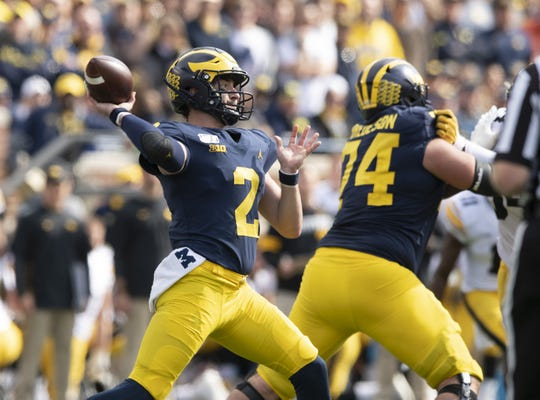 Quarterback Shea Patterson and Michigan are No. 14 in this week's Associated Press Top 25.