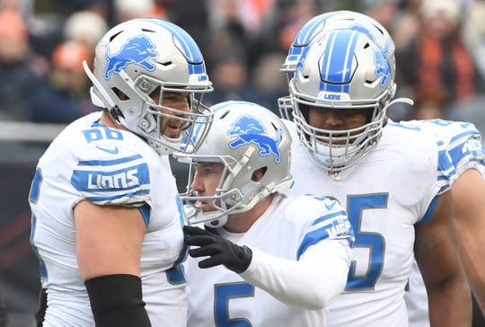 Lions kicker Matt Prater celebrates with teammates Joe Dahl and Tyrell Crosby after putting away a 54 yard field goal in the second quarter.