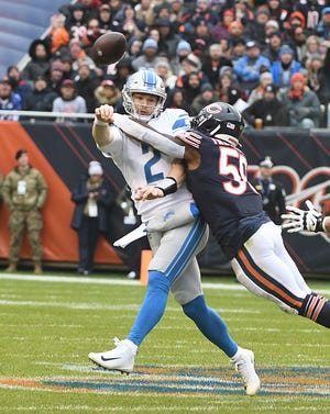 Lions quarterback Jeff Driskel throws under pressure from the Bears' Danny Trevathan in the first quarter Sunday in Chicago.