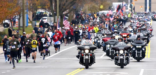 Motorcyclists escort runners and walkers of the 4 Star 4 Mile Race along Trumbull Avenue in Corktown on Sunday, November 10, 2019.
