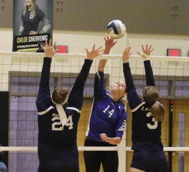 Megan Henry of Candor hits the ball past two Bainbridge-Guilford players during Candor's 3-2 win in the Section 4 Class D volleyball final Nov. 9, 2019 at Corning-Painted Post High School.
