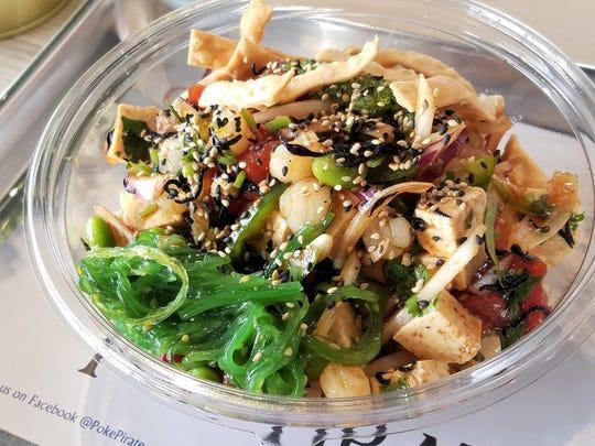 A poké bowl with ahi tuna, tofu, seaweed salad and sesame at the Poké Pirate