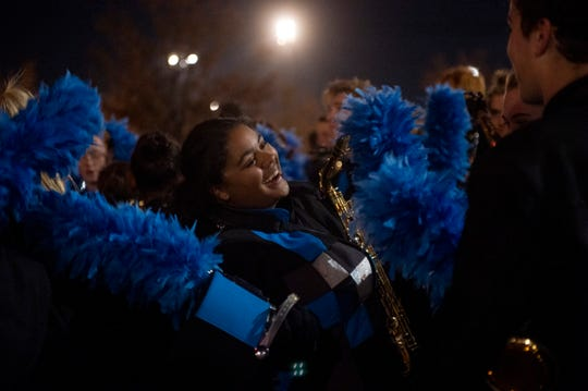 Castle junior Aliyah Lane laughs with friends before going inside for the ISSMA State Marching Band Finals at Lucas Oil Stadium in Indianapolis, Ind., Saturday, Nov. 9, 2019. Castle placed fourth in the Class A competition.