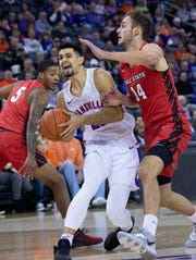 Evansville's Sam Cunliffe (20) drives against Ball State's Kyle Mallers (14) for a layup at Ford Center in Evansville Saturday night, Nov. 9, 2019.