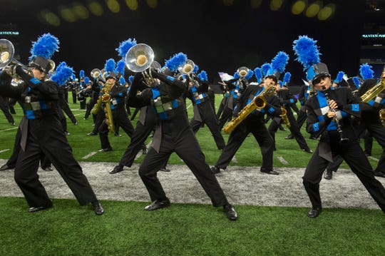 Castle performs at the ISSMA State Marching Band Finals at Lucas Oil Stadium in Indianapolis, Ind., Saturday, Nov. 9, 2019. Castle placed fourth in the Class A competition.