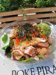 A poké bowl with spicy tuna, shrimp, seaweed and tobiko on spring mix at the Poké Pirate.