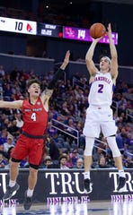 Evansville's Artur Labinowicz (2) shoots over Ball State's Lucas Kroft (4) at Ford Center in Evansville Saturday night, Nov. 9, 2019.