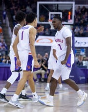 Evansville's Marcus Henderson (1) is congratulated by Evansville's Jawaun Newton (3) after he scored against Ball State at Ford Center in Evansville Saturday night, Nov. 9, 2019.