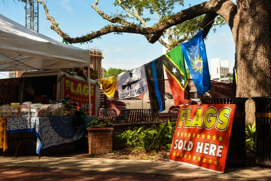"""Hidden among the many tables at Market Wednesday is a single flag vendor, whose choice of products have recently sparked controversy on campus."""