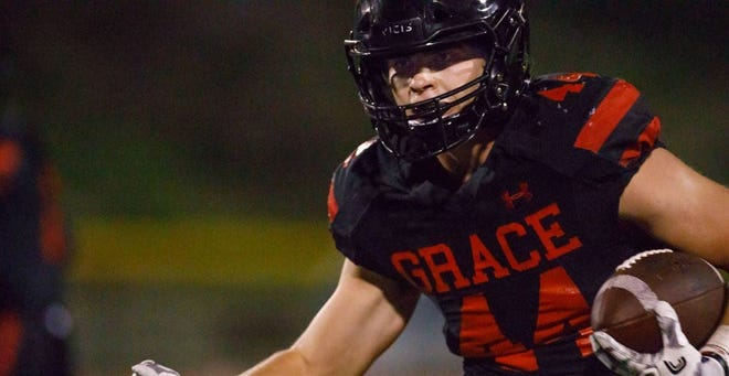 Josh Henderson runs the ball for Grace Brethren High School. Henderson, a running back and linebacker, committed to Colorado State's football program late Saturday night.