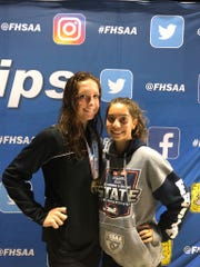 St. John Neumann's Maddy Burt (left) and Chloe Pankita (right) pictured here at the state swimming meet, held in Stuart on Saturday. Burt won the state title in the 100-yard butterfly, the first win in history for St. John Neumann.