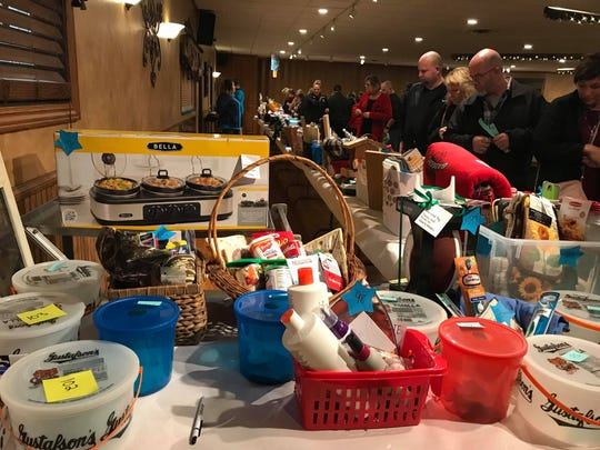 People attended a benefit to raise money for Lisa and Nick Diemel's children at Romy's Nitingale on Nov. 9.