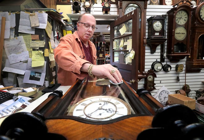 Clocksmith Scott Steel cleans the edges of an 1880's-era clock following a repair of the antique at Kappel's Clock Shop in Maple Bluff, Wis., on Nov. 1, 2019.
