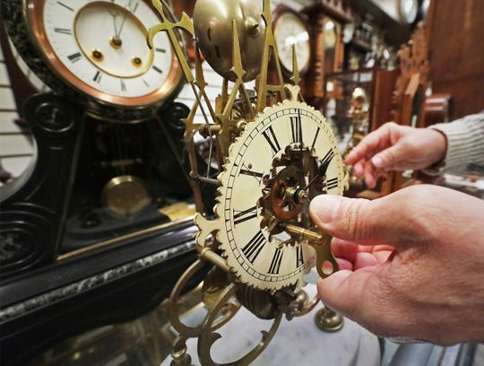 An antique skeleton clock is wound by clocksmith Scott Stee at Kappel's Clock Shop in Maple Bluff, Wis.,  on Nov. 1, 2019.