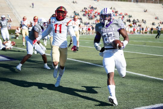 Furman tailback Devin Wynn (22) scores a touchdown while VMI defensive back Riuq Trotman (11) chases him during the game at Furman Saturday, November 9, 2019. Wynn finished with five touchdowns.
