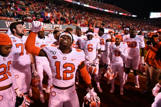Clemson safety K'Von Wallace (12) pumps up his teammates before the NC State game on Saturday, Nov. 9, 2019.