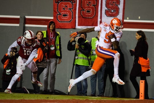 Clemson wide receiver Tee Higgins (5) catches a touchdown in the first quarter against North Carolina State on Saturday, Nov. 9, 2019.