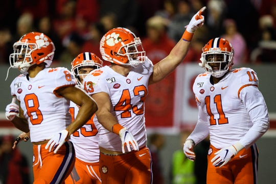 Clemson linebacker Chad Smith (43) reacts after picking up a fumble during their game against NC State at Carter-Finley Stadium Saturday, Nov. 9, 2019.