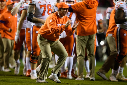 Clemson Head Coach Dabo Swinney celebrates after recovering a fumble during their game at Carter-Finley Stadium Saturday, Nov. 9, 2019.