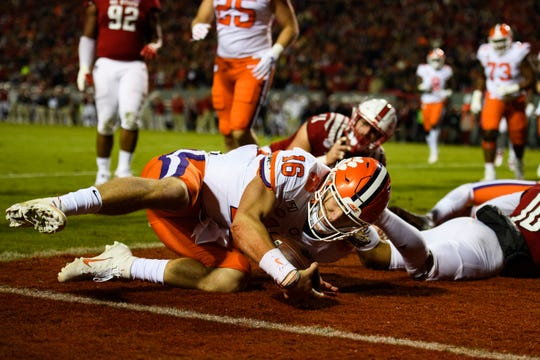 Clemson quarterback Trevor Lawrence (16) scores a touchdown in the first quarter against North Carolina State on Saturday, Nov. 9, 2019.