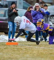 Roy-Winifred's Bobo Adorni crosses the goal line for a touchdown during Saturday's playoff football against Big Sandy.