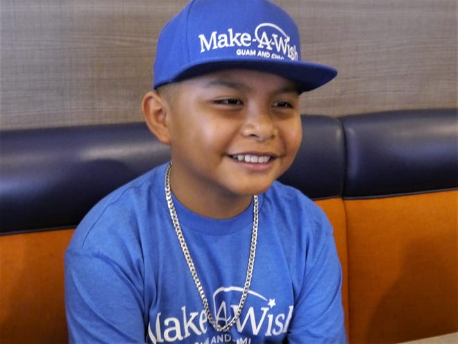 Make-A-Wish Foundation winner Anthony of Yona gets ready for shopping .