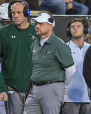 UAB head coach Bill Clark watches the scoreboard during the second half of their Conference USA football game against USM Saturday, Nov. 9, 2019