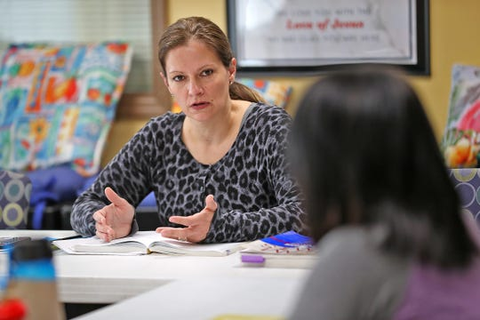 Brandi Moran leads the Genesis class for women in the Higher Ground Recovery program at Wheeler Mission Center for Women and Children, Monday, Oct. 28, 2019.