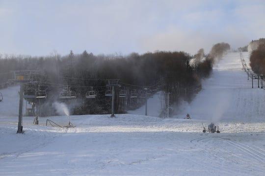 Snow guns blast snow at Greek Peak Mountain Resort.