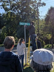 Stacey Davis taught at Bells Elementary for 31 years before she died in summer 2019. The school recognized her dedication to the school by renaming the school street after her. Her son Addison Davis is pictured bolting down the sign on Oct. 22.