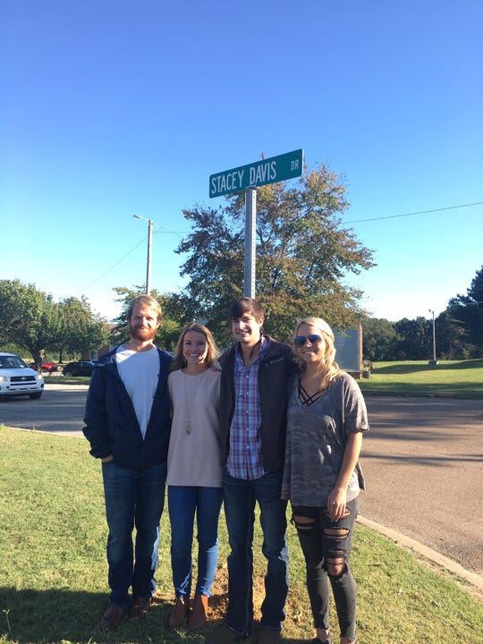 Stacey Davis taught at Bells Elementary for 31 years before she died in 2019. The school honored her life by renaming the school street after her. Pictured, from l to r, are her son-in-law Justin Mosier, her daughter Darby (Davis) Mosier, her son Addison Davis and her son's girlfriend Morgan Henson at the sign dedication on Oct. 22.