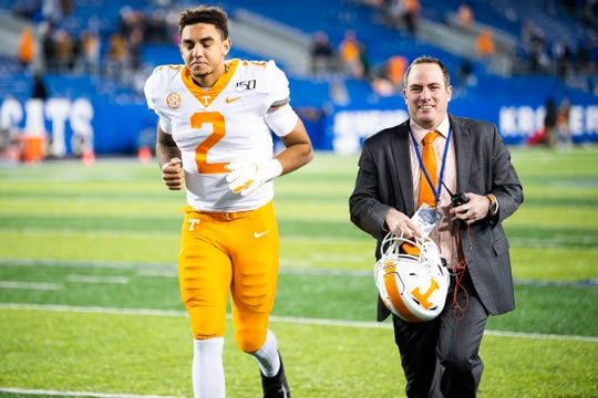 Tennessee quarterback Jarrett Guarantano (2) runs off the field with Zach Stipe, Tennessee Director of Football Communications, after Tennessee defeated Kentucky 17-13 at Kroger Field in Lexington, Ky. on Saturday, Nov. 9, 2019.