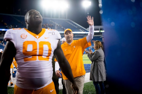 Tennessee football coach Jeremy Pruitt high-fives fans after defeating Kentucky 17-13 at Kroger Field in Lexington, Ky. on Saturday, Nov. 9, 2019.