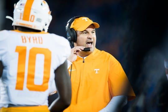 Tennessee football coach Jeremy Pruitt yells to players during a game between Tennessee and Kentucky at Kroger Field in Lexington, Ky., Saturday, Nov. 9, 2019