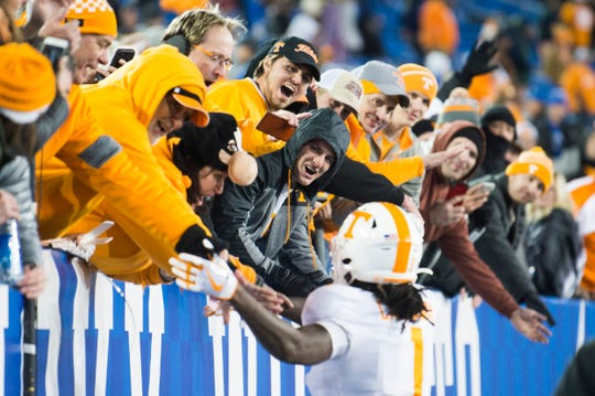 Tennessee wide receiver Marquez Callaway (1) high fives fans after winning a game between Tennessee and Kentucky at Kroger Field in Lexington, Ky., Saturday, Nov. 9, 2019. Tennessee won 17-13.