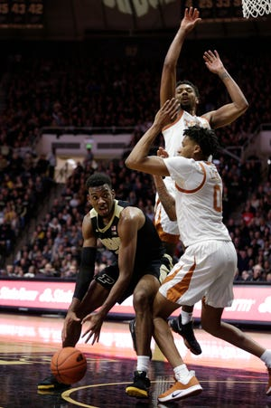 Purdue forward Aaron Wheeler (1) goes up against Texas forward Gerald Liddell (0) during the first half of an NCAA Men's basketball game, Saturday, Nov. 9, 2019 at Mackey Arena in West Lafayette.