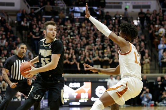 Purdue guard Sasha Stefanovic (55) is guarded by Texas guard Jase Febres (13) during the first half of an NCAA Men's basketball game, Saturday, Nov. 9, 2019 at Mackey Arena in West Lafayette.