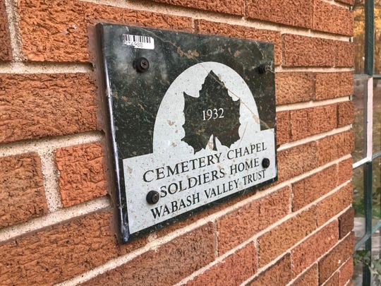 A plaque from the Wabash Valley Trust for Historic Preservation marks the entrance of the Soldiers Home Cemetery Chapel, built in 1932 at the Indiana Veterans' Home near West Lafayette. A service group hopes to raise $40,000 to fix leaks and restore the building.