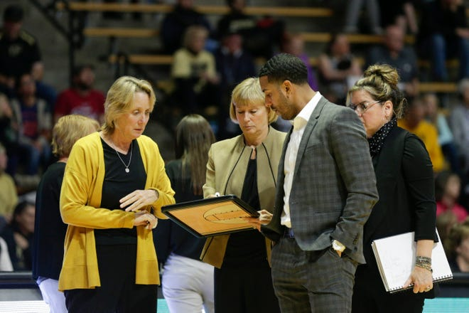 Purdue head coach Sharon Versyp, center, talks with Purdue associate head coach Beth Couture, left, Purdue assistant coach Michael Scruggs, center right, and Purdue senior associate head coach Melanie Balcomb, right, during a time out in the third quarter of a NCAA women's basketball game, Sunday, Nov. 10, 2019 at Mackey Arena in West Lafayette.