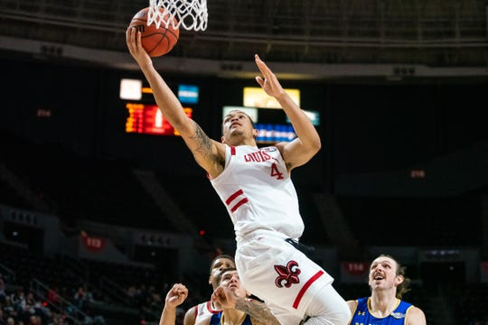 UL's Kobe Julien takes the ball to the basket against McNeese State earlier this season.
