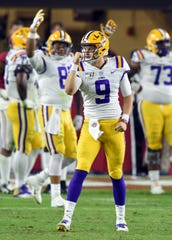 Nov 9, 2019; Tuscaloosa, AL, USA; LSU Tigers quarterback Joe Burrow (9) reacts to a touchdown against the Alabama Crimson Tide during the third quarter at Bryant-Denny Stadium. Mandatory Credit: John David Mercer-USA TODAY Sports