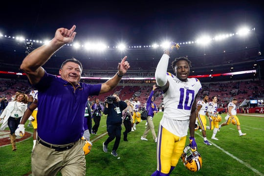 Nov 9, 2019; Tuscaloosa, AL, USA; LSU Tigers head coach Ed Orgeron and LSU Tigers tight end Stephen Sullivan (10) celebrate as they run off the field after defeating the Alabama Crimson Tide 46-41 during the second half of an NCAA college football game at Bryant-Denny Stadium. Mandatory Credit: Butch Dill-USA TODAY Sports
