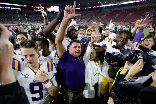 LSU head coach Ed Orgeron celebrates with his players after defeating Alabama on Nov. 9, 2019.