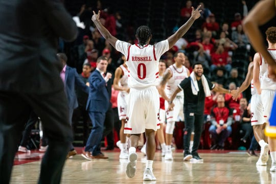 Cedric Russell celebrates after scoring 20 in UL's win over McNeese on Saturday.